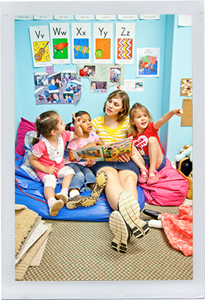 Photograph: A child care worker reads to a group of preschoolers. (Photograph by Alex Lazara)