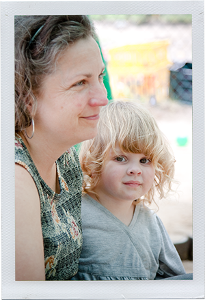 Photograph: A child looks back at the camera while a child care