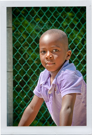 Photograph: A preschool-aged boy looks back at the camera. (Photograph by Alex Lazara)