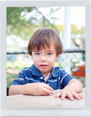 Photograph: A male toddler sits at a table. (Photograph by Alex Lazara)