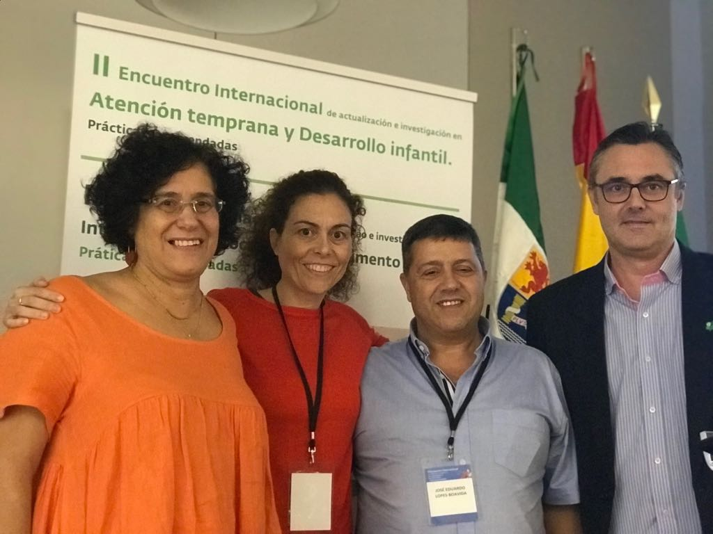 Photograph: Four attendees smiling together at the 2018 2nd International Meeting on latest trends and research in early intervention and child development in Merida, Spain.