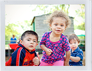 Photograph: Three toddlers look inquisitively at the camera. (Photograph by Alex Lazara)